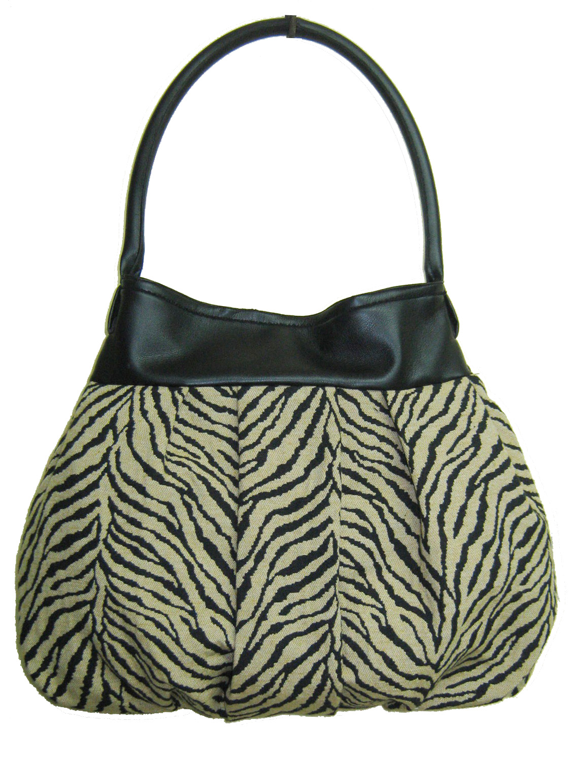 Bolso mediano, con tela de tapicería combinado con cuerina negra en vista y manija, tabla central y pinzas a los costados para dar volumen, manija única con